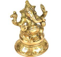 Brass Ganesha Sitting On A Raised Platform