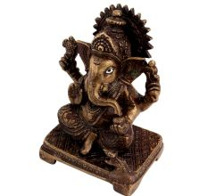 Brass Ganesha Statue Sitting On A Chowki
