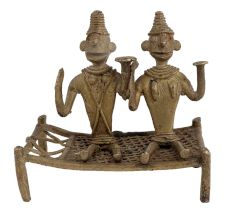 Two Tribal Men Figurines Sitting On Charpai