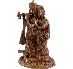 Brass Radhakrishna Statue With Fine Detailing And Peacock