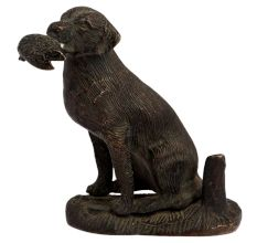 Brass Sitting Dog Statue Holding Flesh Of A Animal
